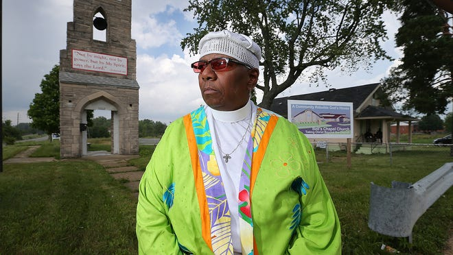 Bishop Adrienne Holmes of Bell's Chapel Church at the would-be site of a new church at 42nd Street and North Mitthoeffer Road.