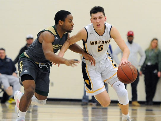 Whitnall's Tyler Herro, right pushes the ball up court