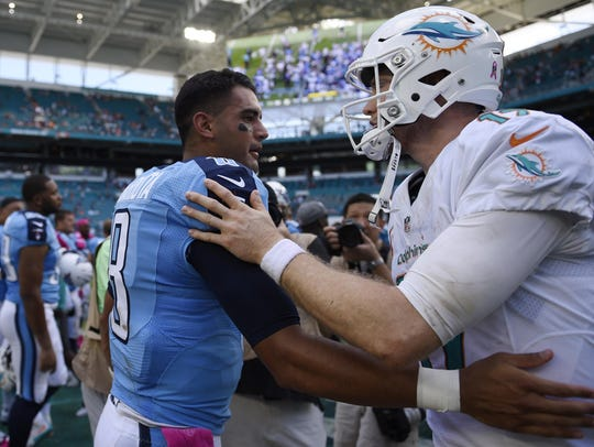 Titans quarterback Marcus Mariota (left) greets Dolphins quarterback Ryan Tannehill (right) after a game in 2016. Tannehill is now headed to Nashville to back up Mariota.