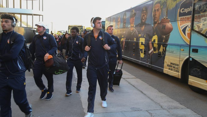 Wilton Speight and the Michigan football team arrive before the 2016 Orange Bowl game against Florida State at the Hard Rock Stadium in Miami Gardens, Fla.