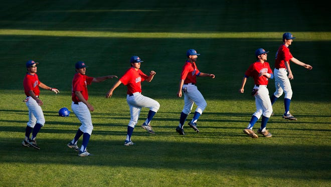 File - Members of the Bartlett Panthers stretch in the field prior to their game against the Arlington Tigers during the 14-AAA baseball tournament at USA Stadium Monday, May 4, 2015 in Millington.