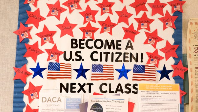 Stickers showing off the first names of people who are either new citizens, marked by a U.S. flag, or hopeful ones, in a building that hosts a series of English culture and language classes held by Neighborhood Christian Legal Clinic and Washington Township Schools, Indianapolis, Friday, 22, 2017.