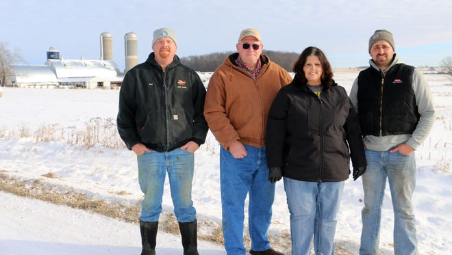 The Rosen family, is pictured on their farm near Emerald this winter, from left, Dan, Dennis, Deb and Dave Rosen.