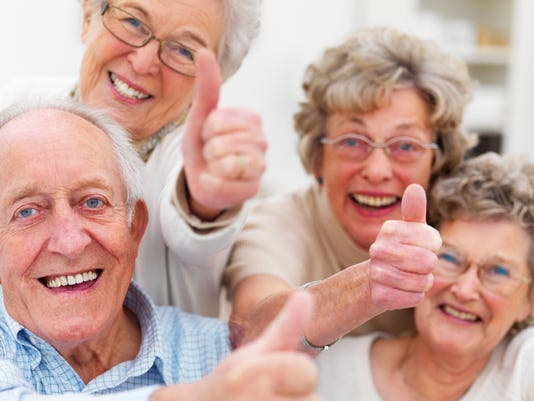 635509602037494265-A-group-of-seniors-with-thumbs-up