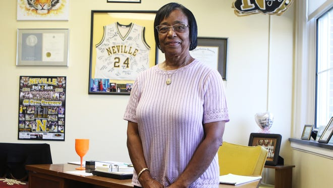 Christella Dawson, principal of Neville High School, poses for a portrait in her office on Wednesday. Dawson began her teaching career at Carroll High School, then moved to Neville in 1969 because of a consent decree that enforced school desegregation. This week, another consent decree caused Dawson to be promoted from assistant principal, a position she had held since 1991, to principal.