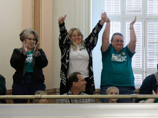 Supporters of a bill to raise California's minimum wage, celebrate the state Senate Gallery after the measure was approved by the Senate Thursday, March 31, 2016, in Sacramento, Calif. The bill, SB3, that will gradually raise California's minimum wage to a nation leading $15 an hour by 2022, was approved by both houses of the Legislature and sent to Gov. Jerry Brown who said he will sign it.