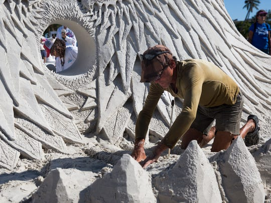 Delays Corbett, right, from Vancouver, Canada and Craig Mutch, from White Rock, Canada work on their master sculptors doubles sculpture on Sunday, November 27, 2016 at the 30th Annual American Sand Sculpting Championship in Fort Myers Beach, Fla. The ten day event ended Sunday with the advanced amateur national and master sculptors doubles competitions.