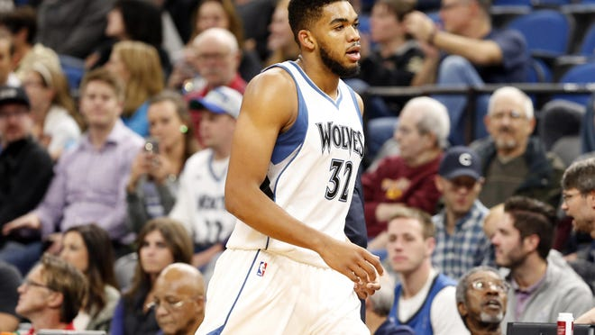 The Minnesota Timberwolves' Karl-Anthony Towns plays against the Memphis Grizzlies in the first quarter Wednesday in Minneapolis.