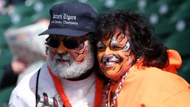 Tony Rinna, 58, and Pam Rinna, 58, both of Southgate, MI, pose for a photograph before the start of Opening Day for the Detroit Tigers at Comerica Park in downtown Detroit, on Friday, April 8, 2016.