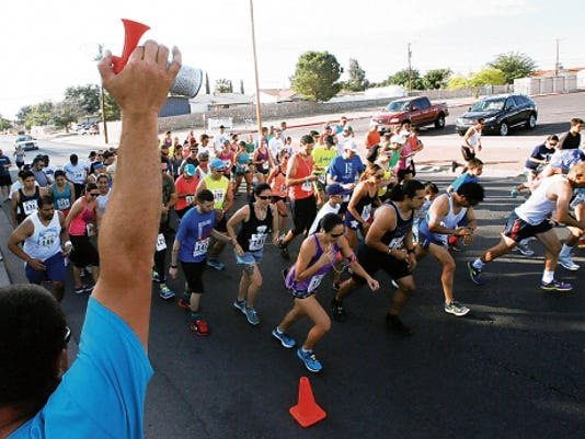 Runners in the Denning Dash 5-K break from the starting line Saturday at Eastwood Park. Send action shots to Vmartinez@elpasotimes.com