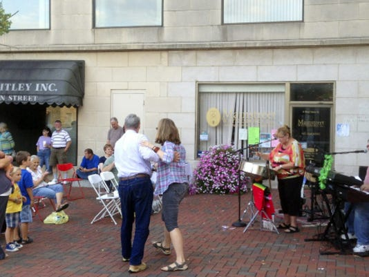 """Folks dance to the music of Island Fusion during the 2014 """"Destination ARTS!"""" season opening at Waynesboro's Center Square."""