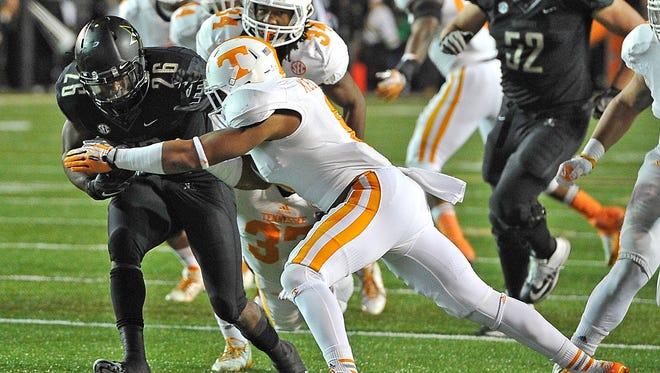 Vanderbilt running back Ralph Webb tries to escape Tennessee defensive back Todd Kelly Jr. last season at Vanderbilt Stadium.