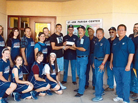 Courtesy Photo   The St. Michael's Knights of Columbus 15062 presented a check in support of the Deming High Lady Wildcat summer basketball program. The money will be used for summer league play and travel to Las Cruces in preparation for the Class 6A season in the winter. Accepting the check in DHS Head Coach Vince Orozco, left. Presenting the check is K of C Guerrero Macias, right.