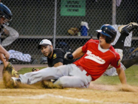 Myerstown's Kyle Knight slides safely under the tag of Fredericksburg's Chase Dubendorf after Ian Whitman flipped him the ball during a four-run seventh inning that helped Myerstown to a 5-2 victory on Monday night at Wenger Field. The win gave the defending county champs a berth in the league championship game opposite Campbelltown.