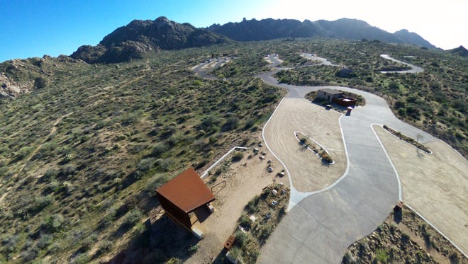 Scottsdale resident Robert Abbott uses a drone for aerial photography in the McDowell Sonoran Preserve. The city is now banning drones in the area.