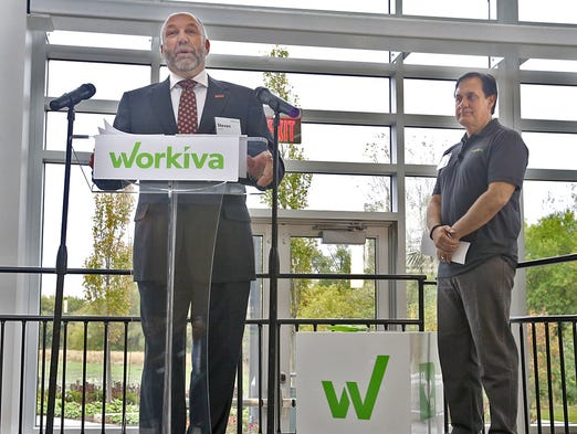 Steven Leath, left, President of Iowa State University, addressed guests and political dignitaries as Matt Rizai, far right, CEO of Workiva, one of Iowaâ??s most successful technology companies, listened at the company's grand opening in Ames on Wednesday Oct. 1, 2014.
