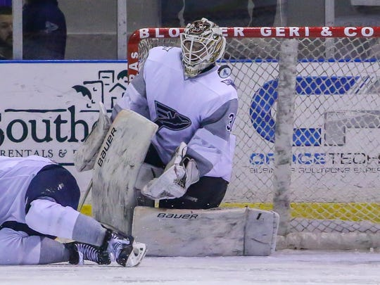 Pensacola goaltender Brian Billett (30) watches as a deflected puck goes across the the net in front of over 5,100 fans at the Pensacola Bay Center on Saturday, December 30, 2017. The Ice Flyers are now 17-4-2 after losing 4-3 in overtime, and remain in first place with 36 points.