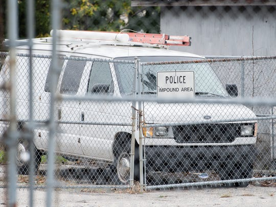 A white van sits in the Hanover Borough Police Department