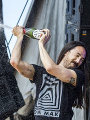 Steve Aoki douses fans with champagne at The Backyard