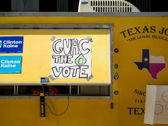 Texas Joe food truck offered tacos to the line of early voters along Broadway Street at the Hamilton County Board of Elections in Cincinnati Saturday, November 5, 2016. Food trucks lined the street to offer voters free food.