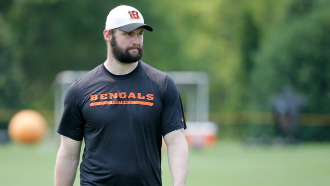 Bengals defensive end Margus Hunt walks the sidelines at OTAs. He missed the workouts with a back injury.