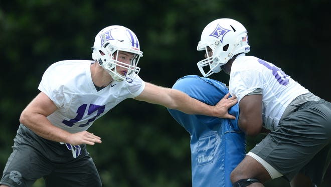 Furman tight ends Duncan Fletcher, left, and Ajay Williams work during a preseason practice.