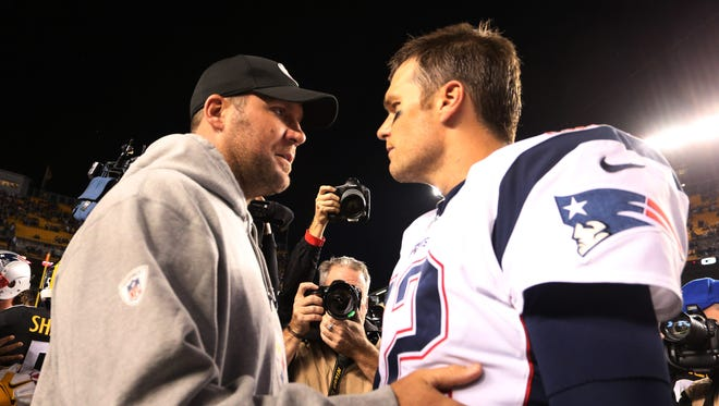 Oct 23, 2016; Pittsburgh, PA, USA;  Pittsburgh Steelers quarterback Ben Roethlisberger (7) and New England Patriots quarterback Tom Brady (12) talk after their game at Heinz Field. New England won 27-16. Mandatory Credit: Charles LeClaire-USA TODAY Sports ORG XMIT: USATSI-268432 ORIG FILE ID:  20161023_ggw_al8_235.JPG