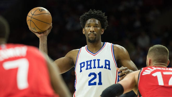 Philadelphia 76ers center Joel Embiid (21) controls the ball against the Toronto Raptors during the first quarter at Wells Fargo Center.