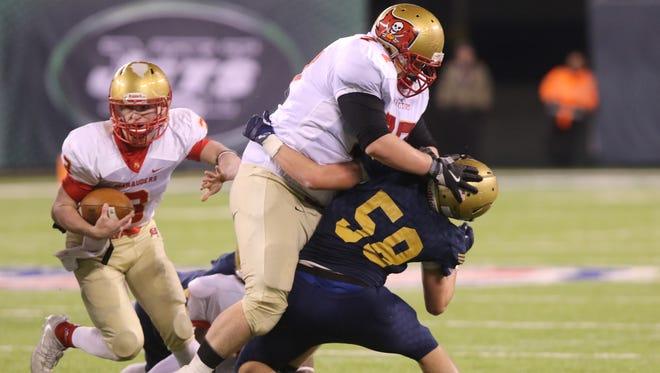 Patrick Olson of Mount Olive, blocks Liam Murphy of Old Tappan to allow his quarterback to run the ball during the first half of the NJSIAA North I Group IV Football Championship in East Rutherford, Sunday, December 2, 2017.