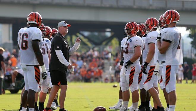 Cincinnati Bengals offensive line coach Frank Pollack instructs the offensive linemen during Cincinnati Bengals training camp practice, Friday, Aug. 3, 2018, on the practice fields next to Paul Brown Stadium in Cincinnati.