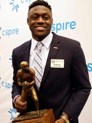 A.J. Brown holds the Conerly Trophy awarded to Mississippi's