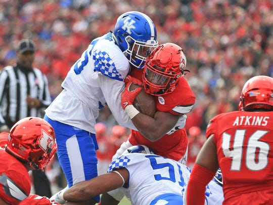 Kentucky's Denzil Ware stops Louisville's Brandon Radcliff from scoring in the first half. The Wildcats stunned the Cards 41-38 to take the Governor's Cup.
