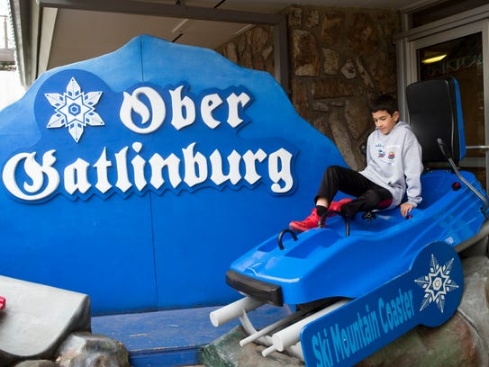 Joey del Pozzo sits inside a display car for Ober Gatlinburg's