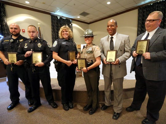 Six law enforcement officials (L to R) MTSU Police Officer Jared Featherstone, La Vergne Police Officer Travis Wilson, Smyrna Police Officer Connie Mangrum, Tennessee Highway Patrol Trooper Dana Vann, Rutherford County Sheriff's Detective D. J. Jackson, and Murfreesboro Police Detective Tommy Massey, were honored at this years  annual Crime Stoppers Officer of the Year Awards Banquet, on Monday July 21, 2014, at the Smyrna Town Centre.