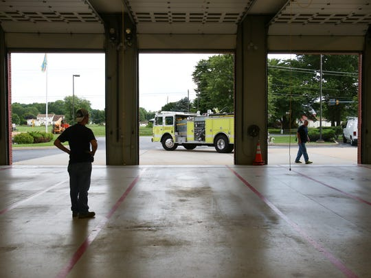 A fire truck prepares to back into a bay at Middletown's Volunteer Hose Co. Fire Station 1Tuesday.