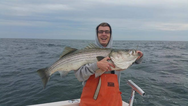 Cain Ernest of Lacey, with an estimated 50-pound striped bass, he caught and released off of Seaside Heights on May 9.