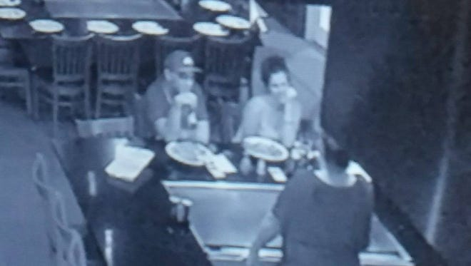 The young couple seen in this photo are suspects in the theft of a bonsai tree from Hana Japanese Steakhouse in Cape Coral last evening.