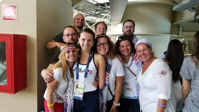 Lizzi Smith's family surrounds her after her third-place finish in the first round of the S9 100-meter butterfly. Lizzi just missed the bronze medal in the final round.