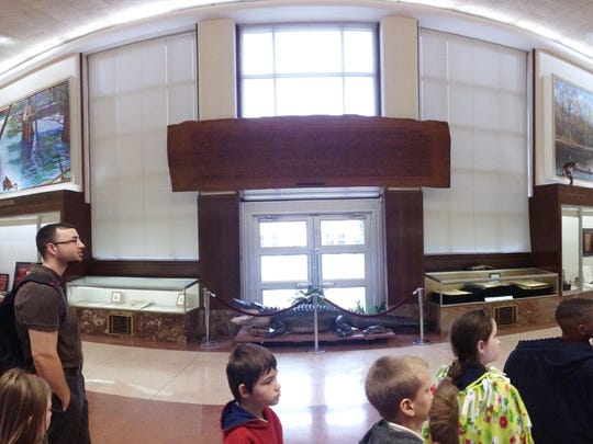 J.P Timmons' third graders walk around the circular building of the Louisiana State Exhibit Museum and look at its displays.