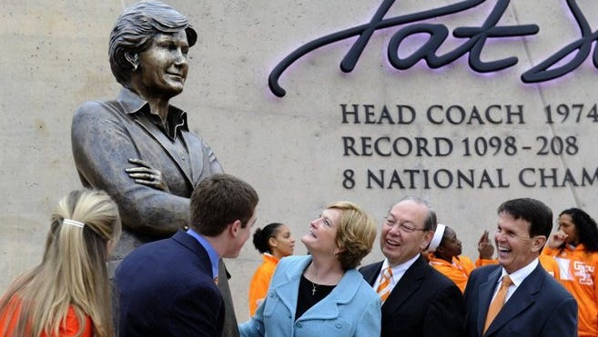 Pat Summitt takes her first clear look at the statue of her unveiled Friday, Nov 22, 2013. The University of Tennessee honored the legendary coach in a ceremony at the corner of Lake Loudoun Boulevard and Phillip Fulmer Way. At left are Tyler Summitt and his wife, AnDe, Summitt, UT Chancellor Jimmy Cheek, and Director of Athletics Dave Hart.