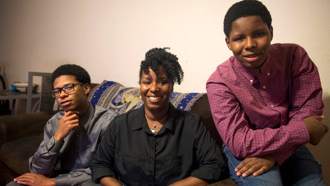 Markisa, center, with her two sons Kindred, left, and Noble, right, at her home in Mechanicsville.
