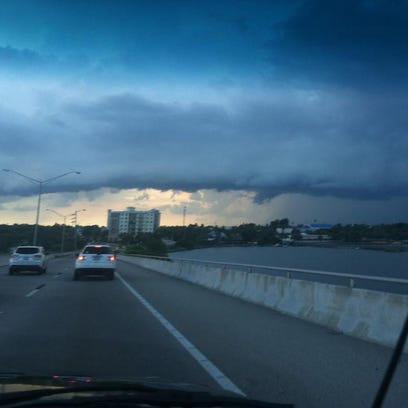 FILE - Approaching storms as seen from the Eau Gallie
