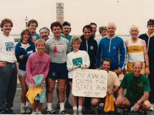 Michelle Zechman's father David Thomure, standing in the front row in the gray shirt next to wife Shirley in the white shirt, after a cross-state run with fellow Pike Creek Valley Running Club members in 1987.