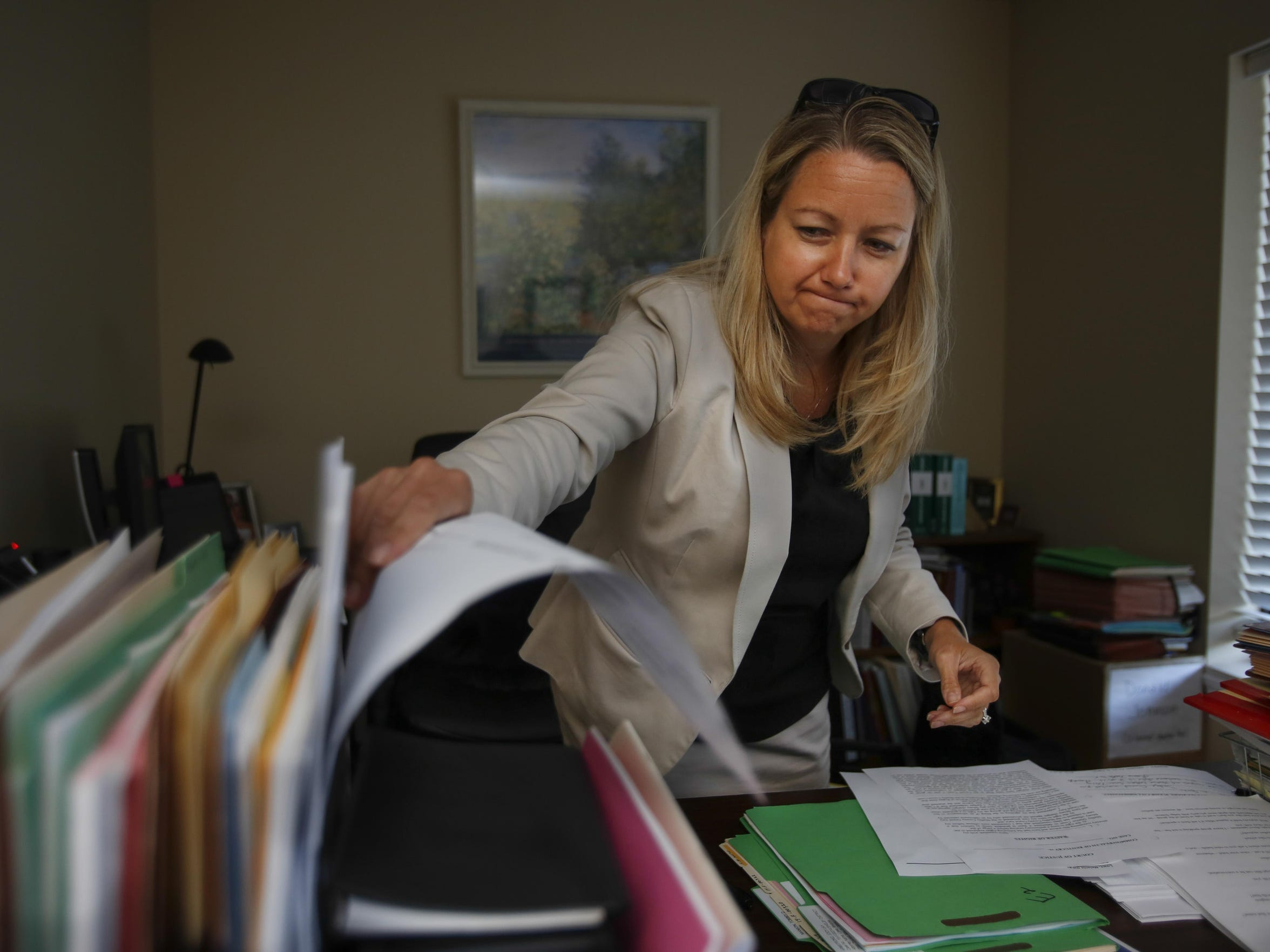 Assistant Public Advocate Melanie Lowe finishes paperwork