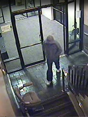 The suspect in Friday night's armed robbery of Richmond's Eagles Club was described as a white male wearing a gray, hooded sweatshirt, blue jeans, white tennis shoes, white gloves and some type of cloth covering his face.