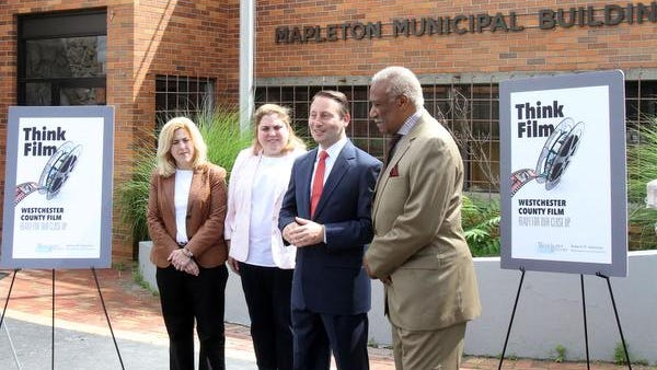 From left, Nicole and Gabrielle Zeller, owners of Haven Studios in Mount Vernon, Wstchester County Executive Rob Astorino and Mount Vernon Mayor Ernie Davis, talk about the film industry in Westchester while standing outside Haven Studios June 27, 2014. Haven Studios is being used by HBO to film a show.