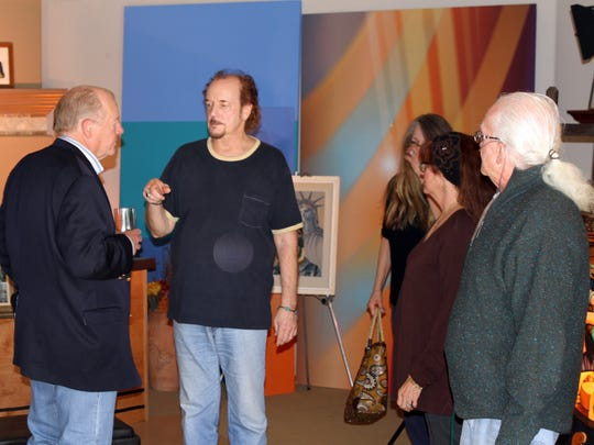 PBS producer and host Terrel Cass chats with director Chip Miller, as video producer Travis Miller, Kingston Trio executive Bobbi Childress-Shane, and sole surviving originamember of the Kingston Trio, Bob Shane, looks on at Miller's Desert C.A.M. Studios.