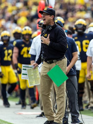 Jim Harbaugh shouts at officials after a Michigan penalty in the third quarter of the Wolverines' 29-13 win over Air Force at Michigan Stadium on Sept. 16, 2017.