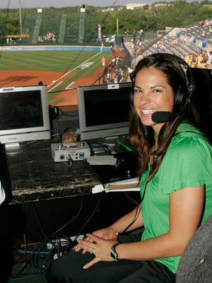 "FILE - In this May 29, 2009 file photo, USA softball player Jessica Mendoza poses for a photo in the ESPN broadcast booth at the Women's College World Series in Oklahoma City.  Mendoza chatted up Kyle Schwarber, broke down pitcher's tendencies and dealt with social media criticism in her historic first full season covering baseball for ESPN. Mendoza recently shuttled between Cleveland and Chicago, giving World Series updates eight times a day for ""Baseball Tonight"" and ""Sports Center."""