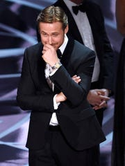 """FILE - In this Feb. 26, 2017, file photo, Ryan Gosling reacts as """"Moonlight,"""" is announced as the actual winner of best picture at the Oscars in Los Angeles. It was originally announced that Gosling's film,  """"La La Land"""" won best picture."""
